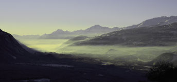 Switzerland valley. When the sun disappeared behind the mountain Stock Image