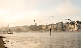 Switzerland, view at the River Rhein in Basel in the morning fog Stock Photos