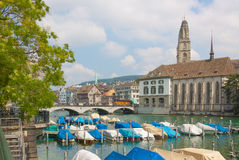 Switzerland. Zurich. The Limmat River. The summer of 2015.Parking of boats and boats on the Limmat river Royalty Free Stock Photo
