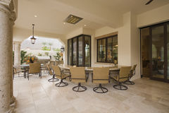 Swivel Armchairs At Outdoor Home Bar Area Stock Image
