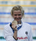 SWM: Чемпионат Aquatics мира - выпускные экзамены фристайла 100m женщин Стоковая Фотография