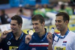 SWM: Campeonato de los Aquatics del mundo - final para hombre de la mariposa del 100m Foto de archivo