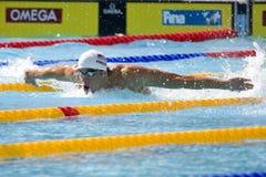 SWM: Campeonato dos Aquatics do mundo - qualificador da borboleta dos homens 200m Fotos de Stock