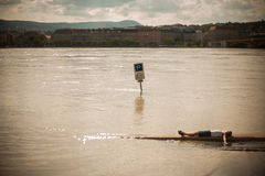 Swollen Danube. Kid lying on the bank of the swollen Danube  in Budapest Royalty Free Stock Photos