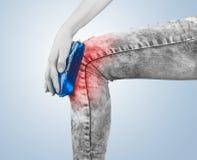 Swollen hurting knee Stock Photography