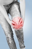 Swollen hurting knee. Stock Photos