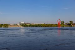 Swollen Missouri River at Omaha Nebraska Riverfront flooding Tom Hanafan River`s edge park in Council Bluffs Iowa. Flood water forming an internal sea flooding royalty free stock photo