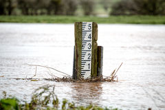 Swollen River. Flooding High Marker Gauge Royalty Free Stock Photo