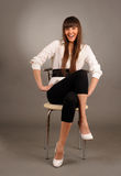 Swoman sitting on a chair Royalty Free Stock Image