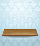Swooden shelf on beautiful wall Stock Images
