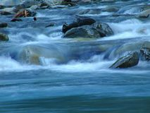 Swoosh!. Water flowing down a stream and over some rocks Royalty Free Stock Photo