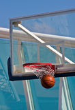 Swoosh Through the Net. A basketball swishing through a net Stock Photos