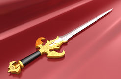 Sword. Laying on a red silk fabric Royalty Free Stock Image