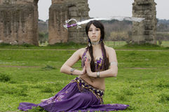 Sword. Belly dancer and sword in the park Stock Photo