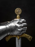 The sword of the Crusader and the knight's glove. Royalty Free Stock Photo