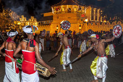 Sword dancers perform in front of the Temple of the Sacred Tooth Relic in Kandy in Sri Lanka. Royalty Free Stock Image