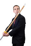 Sword Fight. A civilian sword fighter, wearing a formal suit and carrying his bamboo practice sword, isolated against a white background Stock Photos