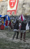 Sword fight between knights in historical re-enactment Royalty Free Stock Image