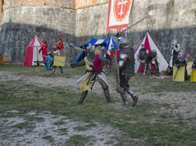 Sword fight between knights in medieval fair Royalty Free Stock Image