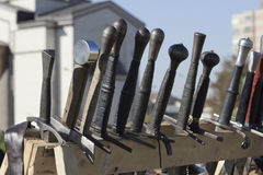 Sword handles. Handles of swords placed in wooden stand at the festival Days of Fortress Oradea, Romania Stock Photography