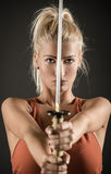 Sword In The Hands Of A Beautiful Woman Stock Photos