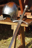 Sword and helmet medieval weaponry Royalty Free Stock Image