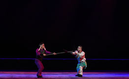 "Sword and lance fight-Peking opera ""Little Worriors of Yeuh's family"" Royalty Free Stock Photos"