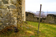Sword in medieval castle backyard Royalty Free Stock Images