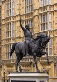 Sword raised in the air astride a prancing horse. Sword raised in the air astride a prancing horse, Richard the Lionheart is depicted outside of the British Royalty Free Stock Photos