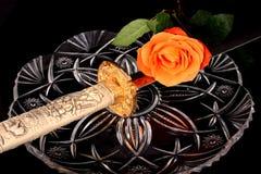 Sword and rose Stock Photos