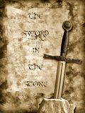 Sword in the stone. Medieval sword hammered in a stone over grunge background Stock Images