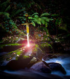 Sword and stone. Sword stuck in a river rock Stock Images