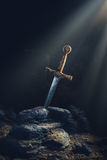 Sword in the stone excalibur Stock Images