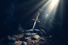 Sword in the stone excalibur Royalty Free Stock Image