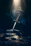 Sword in the stone excalibur Royalty Free Stock Photography