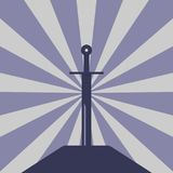 Sword in the stone.Silhouette of medieval weapon. Sunshafts background Royalty Free Stock Photo