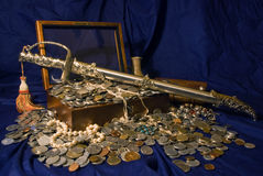 Sword treasure. Treasure chest filled with coins and a sword stock photography