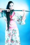 Sword and woman Stock Image
