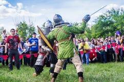 The swordfight heavily armed medieval warriors Royalty Free Stock Photos