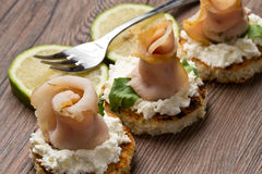 Swordfish canape. Some swordfish canape on wooden table royalty free stock image