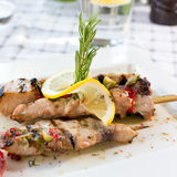 Swordfish fillet. Grilled with souse, lemon and rosemary Stock Images