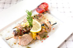 Swordfish fillet. Grilled with souse, lemon and rosemary Stock Photo