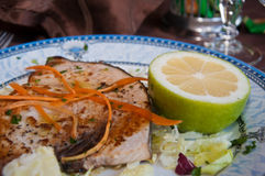 Swordfish grilled with lemon and salad Royalty Free Stock Photography
