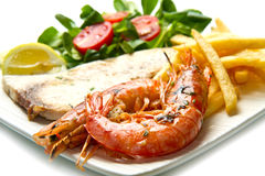 Swordfish and grilled prawns Royalty Free Stock Photos