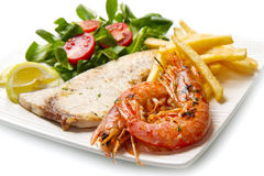 Swordfish and grilled prawns Stock Images