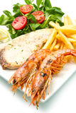 Swordfish and grilled prawns Stock Photography