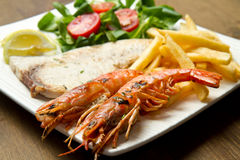 Swordfish and grilled prawns Stock Photo
