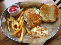 Swordfish Sandwich Platter With Fries and Coleslaw Stock Photo