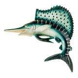 Swordfish. A small swordfish fridge magnet made in plastic and isolated over white Royalty Free Stock Photography
