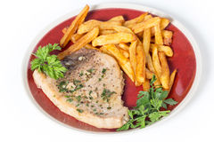Swordfish steak and fries Royalty Free Stock Image